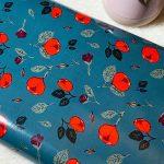 Tissu laminé/hydrofuge Roses fond vert foncé