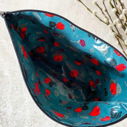 Trousse enduite en tissu chambray coton bio couleur vert d'eau à pois blancs et tissu laminé/enduit à l'intérieur